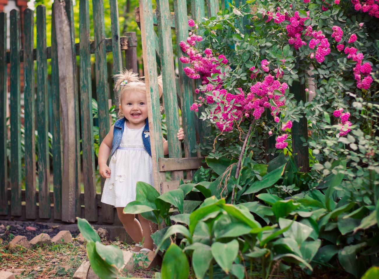 female toddler in the garden
