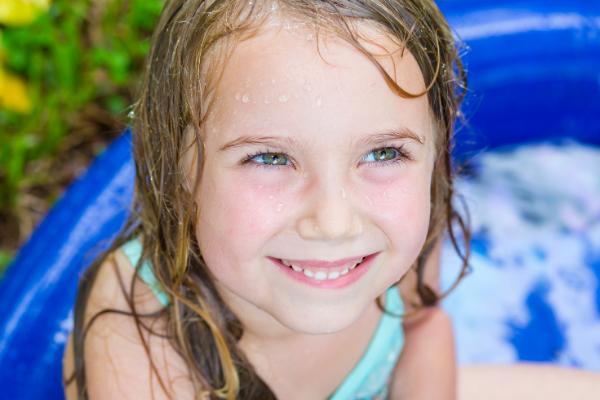 playing in the pool in the backyard