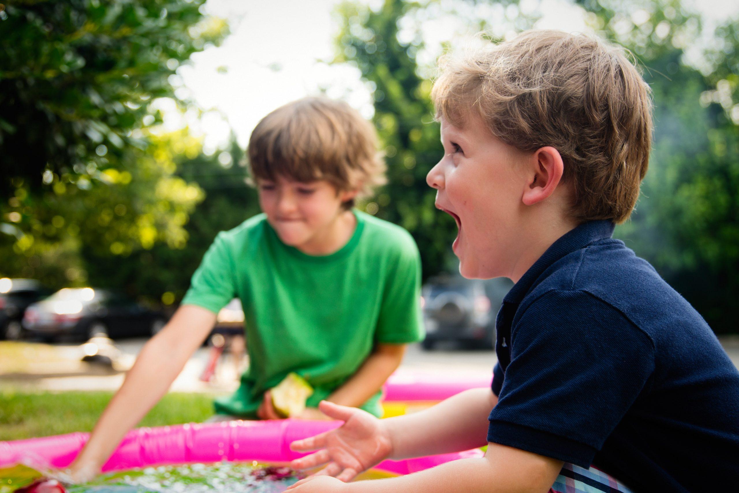 boys playing in the backyard